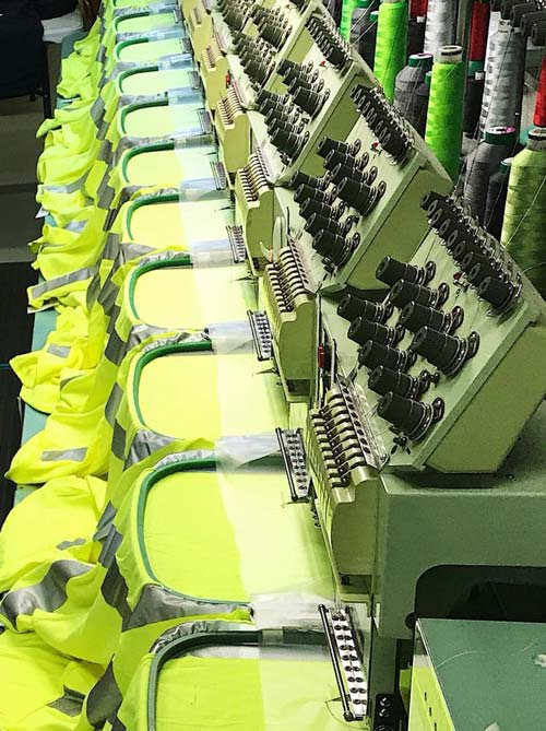 Photo of our machines embroidering multiple shirts.